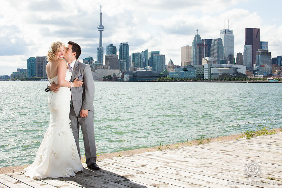 a couple pose for a photo at their toronto wedding